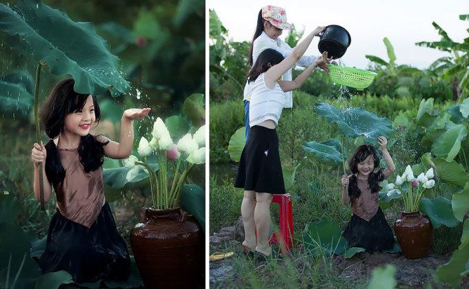 <p> Bé gái vui đùa với mưa từ rổ và nồi cơm điện.</p>
